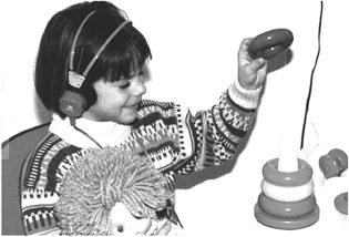 Play Audiometry. The child places a ring in the plastic base, every time she hears a sound from the headphones.